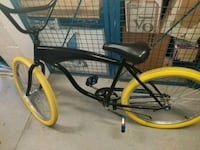 Bike with black body and yellow tires Toronto, M4M 3N5