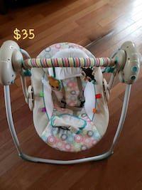 baby's white and blue swing chair