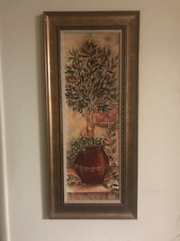 indoor plant painting with brown pot and silver frame