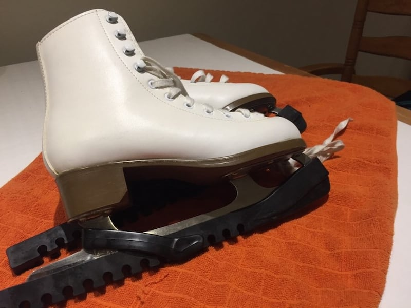 Size 5 and 6 two pairs of Skates with blade protectors b4a99d6f-3f0c-4572-a1fb-c810bb061f35