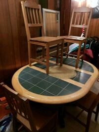 round brown wooden framed glass top table 135 mi