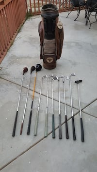 three black golf drivers, six gray golf wedges, on