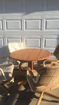 Table and chairs ....   table folds in on both sides for smaller spaces Greeley, 80634
