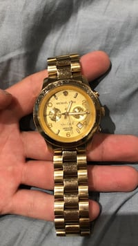 Round gold michael kors chronograph watch with gold link bracelet Calgary, T3K 5K4