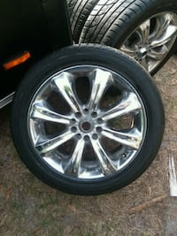 chrome multi-spoke car wheel with tire Fort Myers