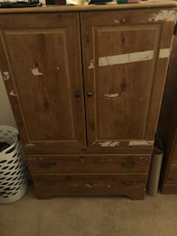 "Armoire free. When we moved I put packing tape on it to keep it closed but the tape took off part of the color. Movers also damaged part of the corner. We're upgrading our bedroom set so we're giving it away. It's 60""x 38"" San Diego, 92122"