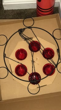 black and red metal candle holder