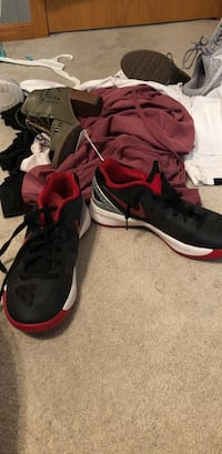 pair of black-and-red Nike basketball shoes Omaha, 68116