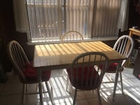 rectangular brown wooden table with four chairs dining set San Antonio, 78247