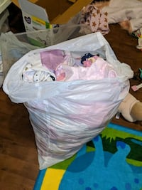 Garbage BAG full of baby girl clothes