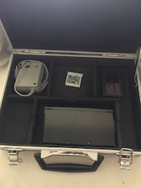 Nintendo 3DS and 4 games and briefcase to hold all Longview, 75603