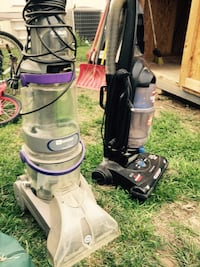 Two white and black upright vacuum cleaners Garden City, 67846