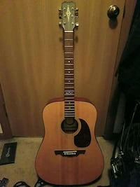 brown and black acoustic guitar Moraine
