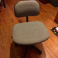 Gray and black rolling chair