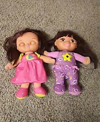 purple and pink dressed female dolls