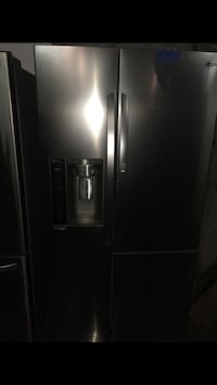 LG Side by Side Fridge with compartment door in Excellent Condition Baltimore, 21223