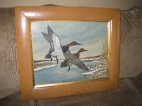 two white-black-and-brown birds painting with brown frame