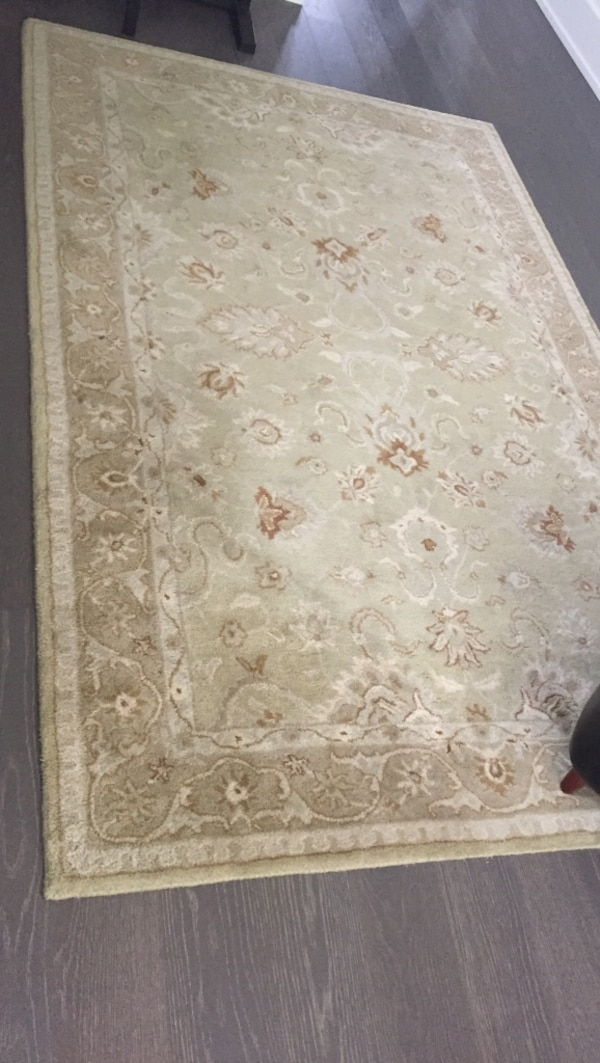 White and brown floral area rug
