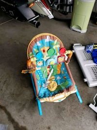 baby's blue and green bouncer Bowie