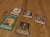 five Yu-Gi-Oh trading cards