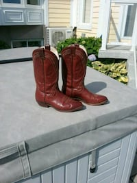 pair of brown leather cowboy boots Delson, J5B 1A4