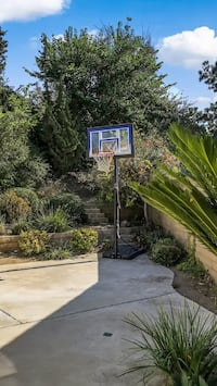 Black and blue basketball hoop/system. Chino Hills, 91709