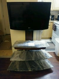 black flat screen TV with black wooden TV stand 973 mi