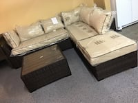Outdoor sectional with coffee table. Brand new. Keller