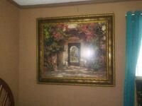 brown wooden framed painting of house 396 mi