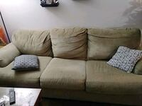 Couch. Heavy duty fabric. Tan w/new grey cover