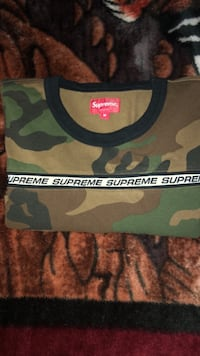 Black and green camouflage supreme sweater 64 km