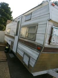 white and brown camper trailer