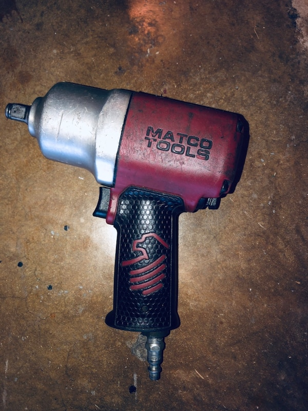 Black and red snap-on impact wrench