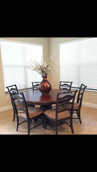 """60"""" round table , pedestal base, 6 chairs, beautiful dark wood. Like new condition  Crofton, 21114"""