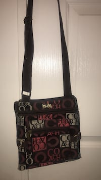 monogrammed red, black, and brown Coach crossbody bag