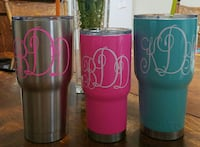 three silver, pink and blue steel tumblers
