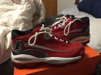 Red-and-white reebok answer series basketball shoes