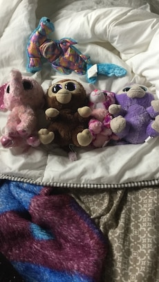 Five assorted animal plush toys