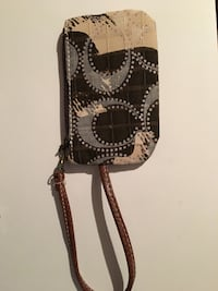 brown and black Coach leather wristlet Clearview