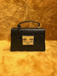 black monogrammed Louis Vuitton leather wristlet Brampton, L6Y 4S5