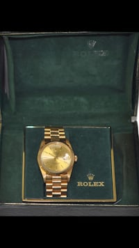 round gold-colored Rolex analog watch with link bracelet New York, 11378
