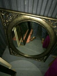 Silver maybe bronze framed wall mirror 54 km