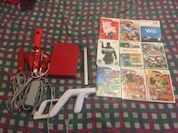 Red nintendo wii game with 2 controllers and 9 games works like new Lilburn, 30047