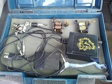 assorted tattoo machines with power supply