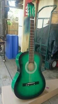 green and black classical guitar Houston, 77091