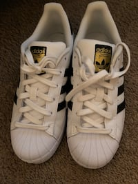 pair of white adidas Superstar shoes West Melbourne, 32904