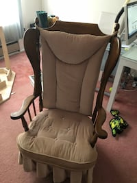 Brown wooden framed rocking chair. The wood is in excellent condition. Nice smooth rock with a wider seat. The cushions are in good condition, clean with no rips. They could easily to recovered.   Brick, 08723