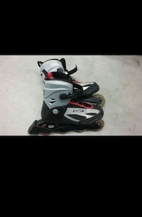 gray red and black light inline skates