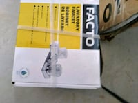 FAUCET. UNOPENED BOX.