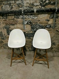 two white-and-gray bar stools